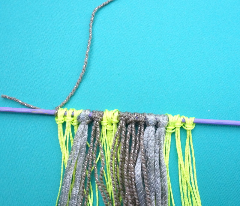 Form a wall hanging handle with yarn