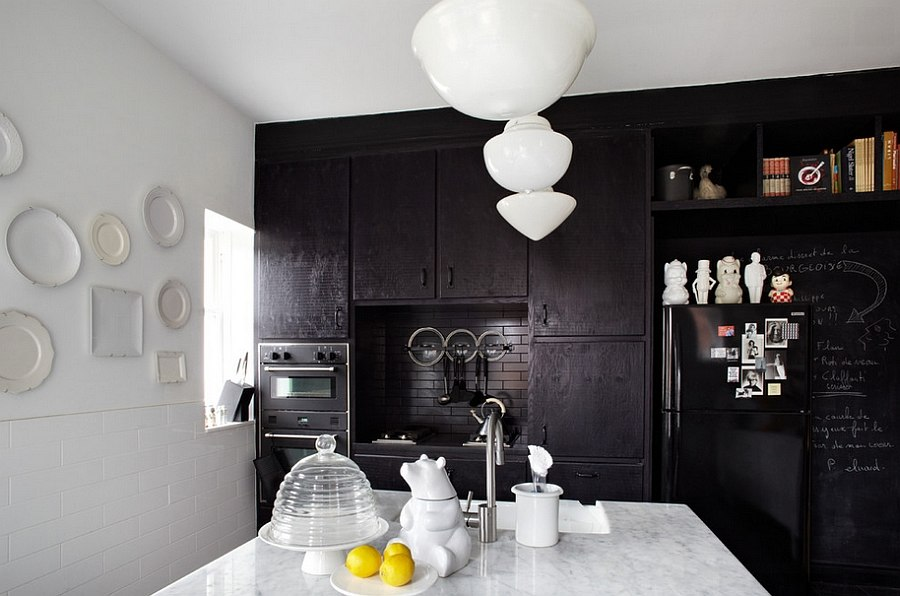 Give your kitchen a sophisticated dark backdrop [Design: Stephane Chamard]