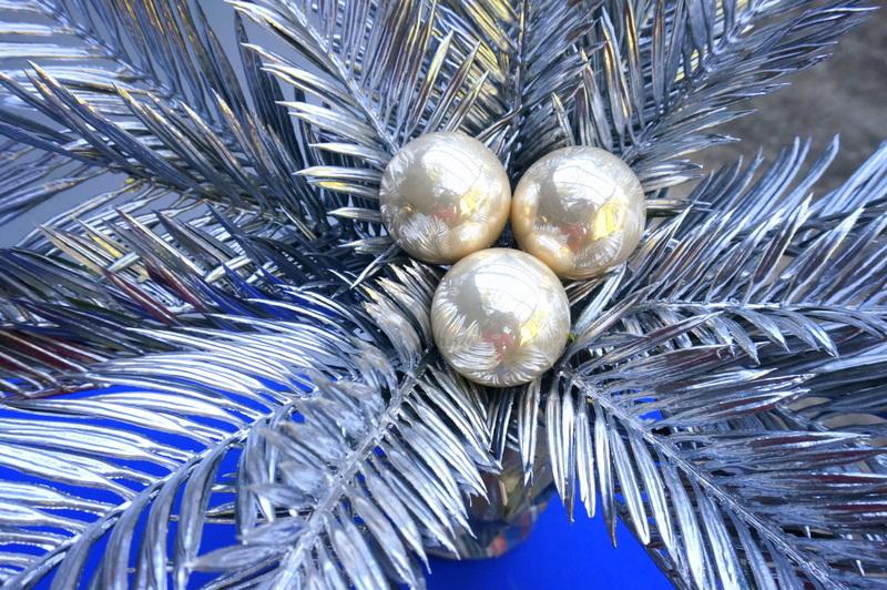 Glue three ornaments to the center