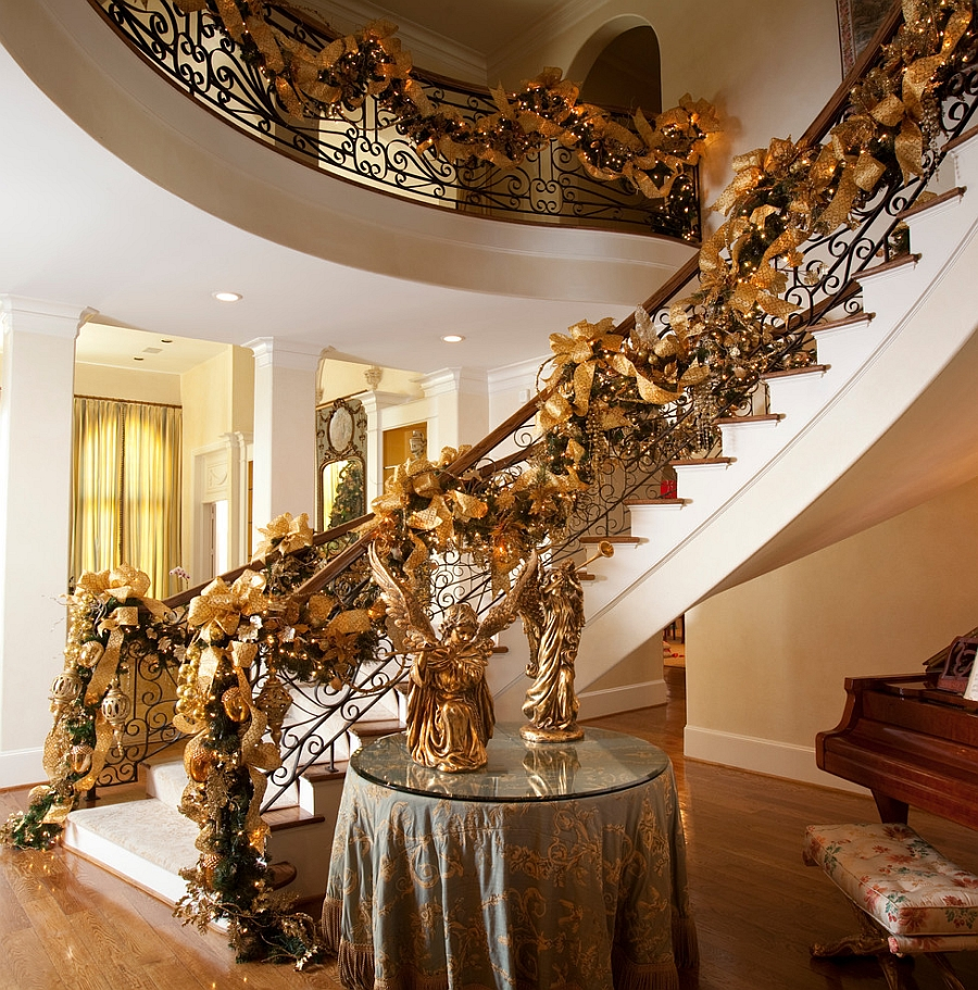 Gorgeous Christmas staircase decorations in gold [Photography: Julie Soefer]