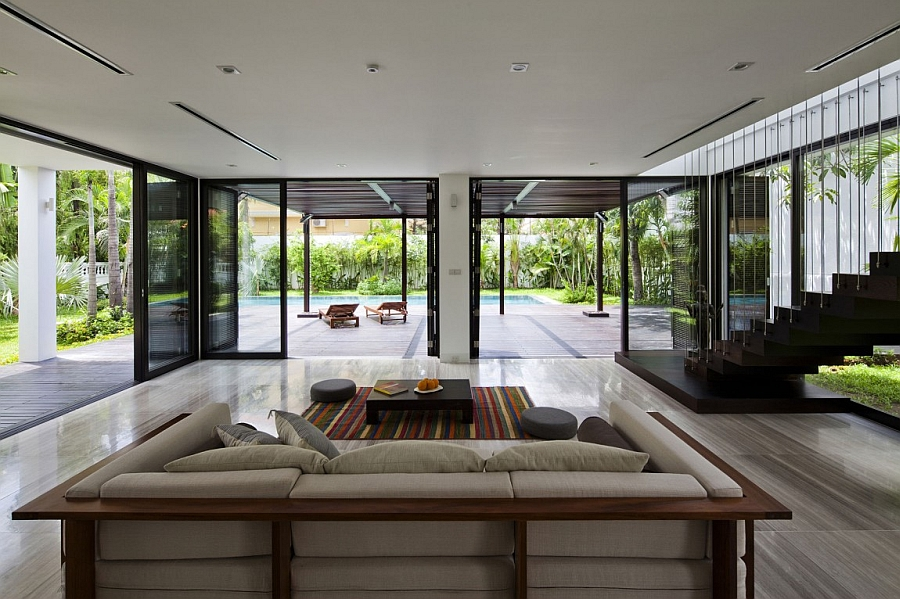 Gorgeous living area design opening towards the pool and backyard