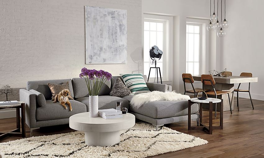Gray sectional sofa in a modern eclectic space
