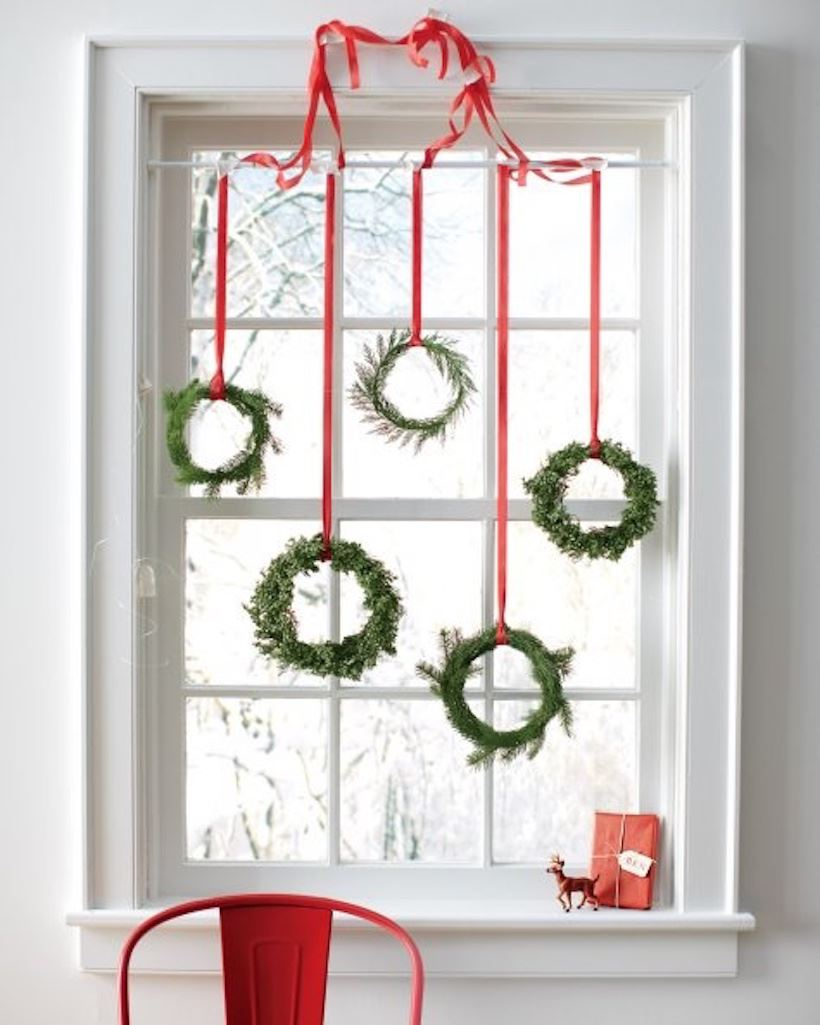 Hanging wreaths in the window