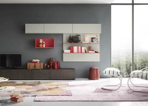 Hot pink enlivens the creative living room wall unit