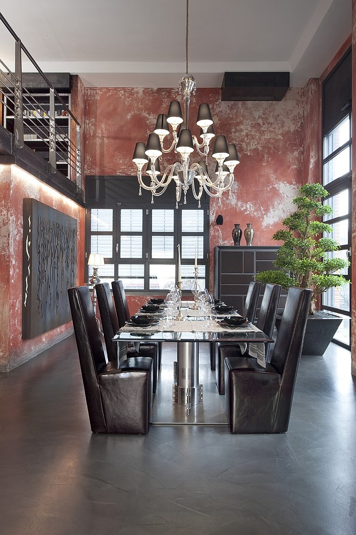 Industrial dining room with a muted red backdrop