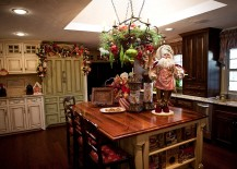 Kitchen island with Christmas ornaments and Santa figurine