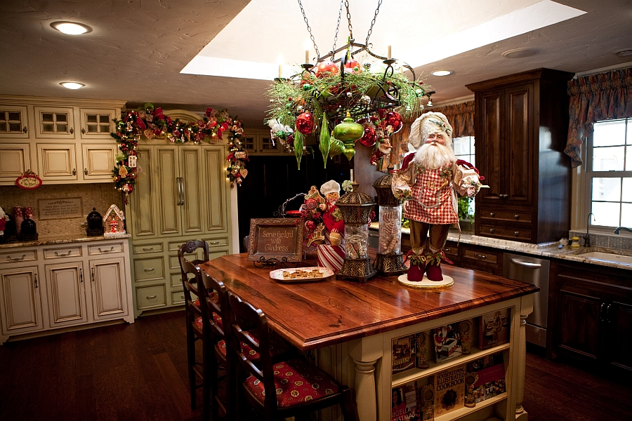 kitchen island with christmas ornaments and santa figurine - Show Me Christmas Decorations