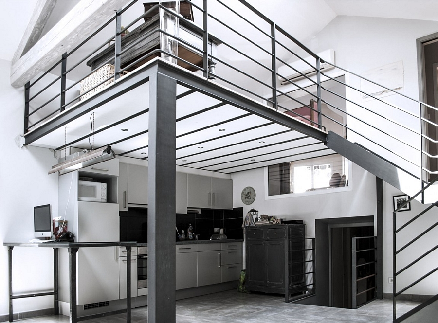 Kitchen nestled beneath the overhang of the top level