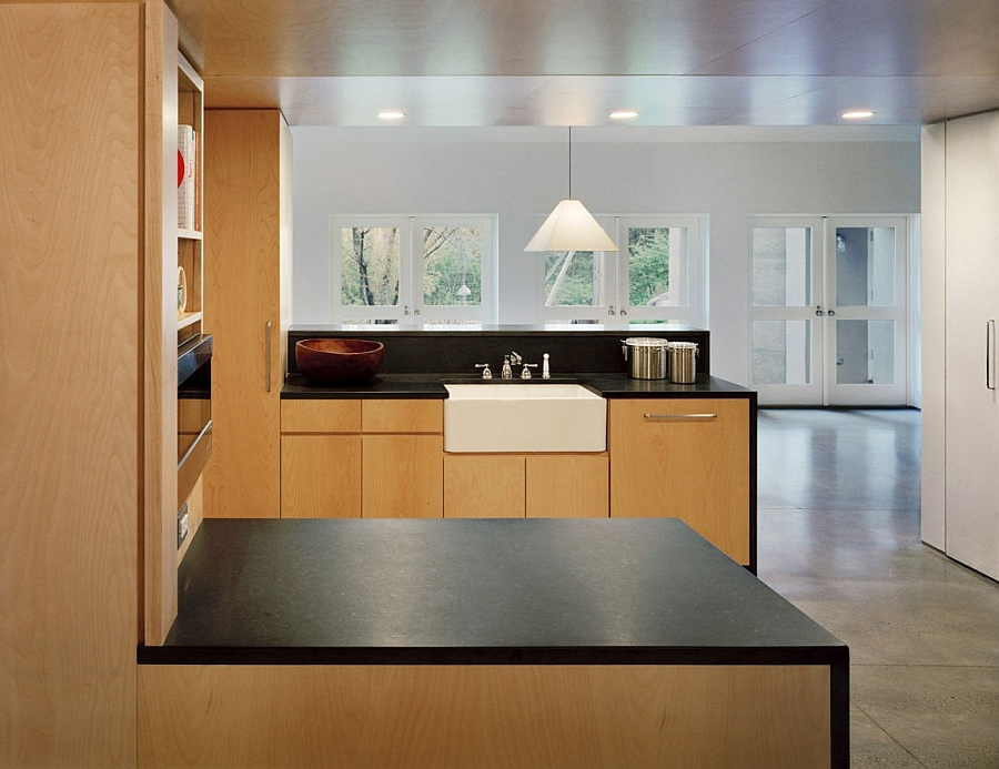 Kitchen with polished concrete floors and warm wooden elements