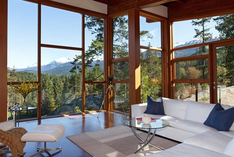 Large glass doors and windows offer panoramic views from the living room