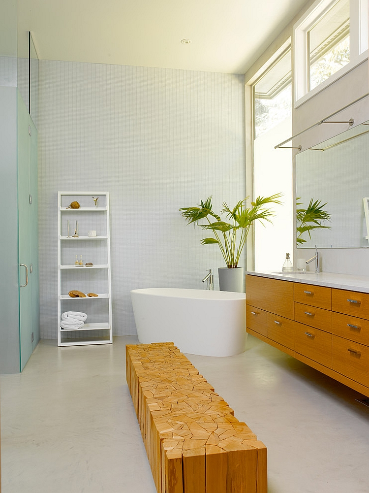 Lavish contemporary bathroom with a standalone tub and a unique wooden seat