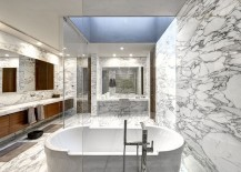 Lavish master bath draped in marble
