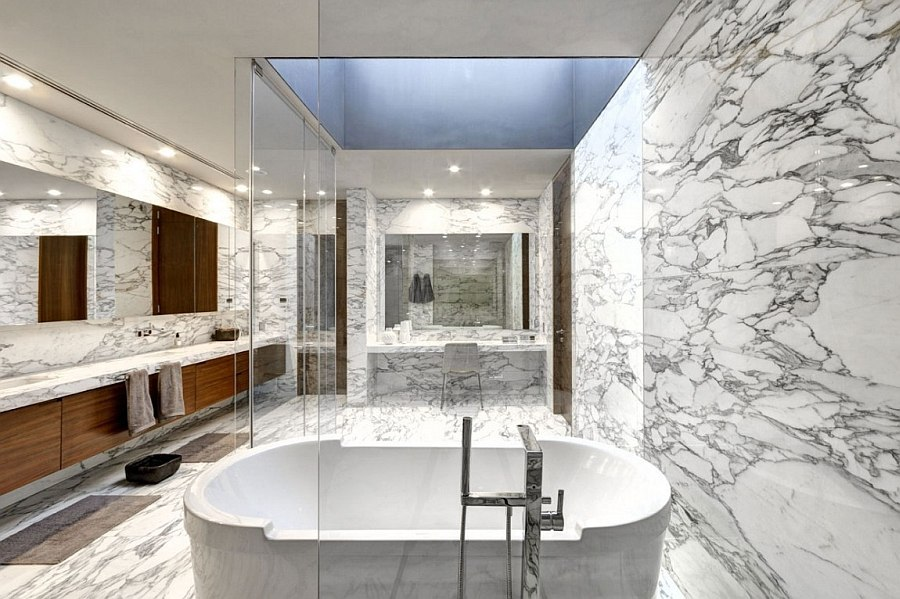 Lavish master bath draped in marble