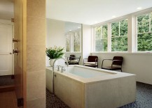 Master bath with a view of the lush landscape canopy outside