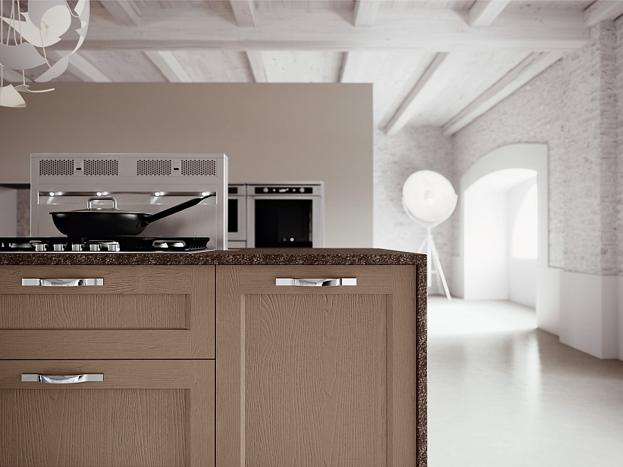Metallic handles bring a touch of glitter to the lovely kitchen