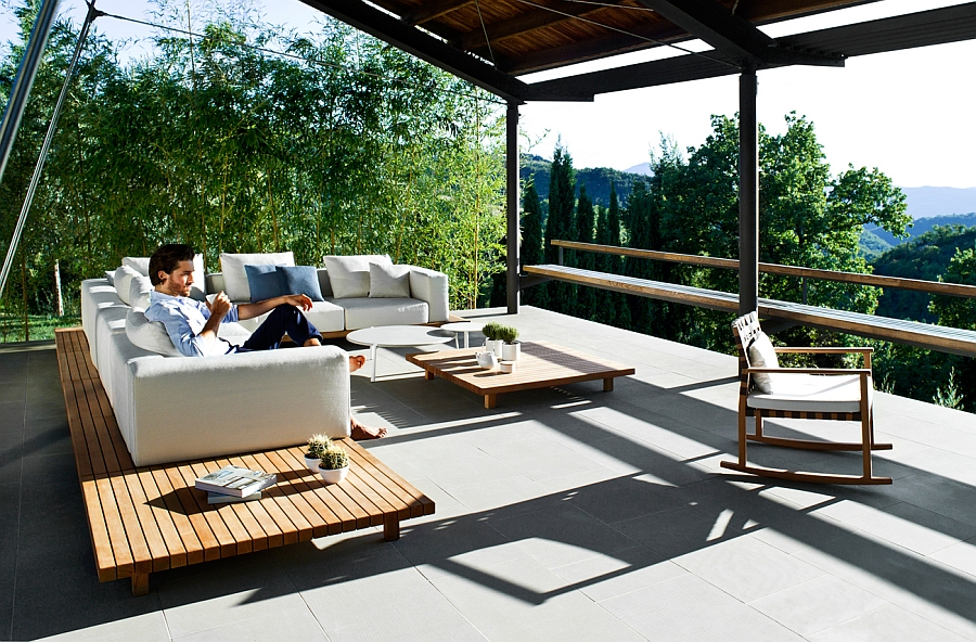 Minimal and gorgeous outdoor sofa with a teak base