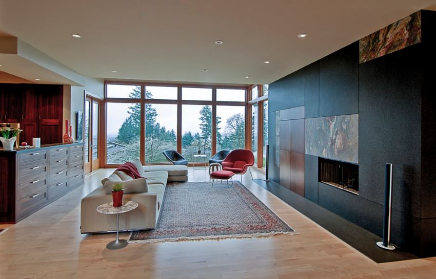Modern living room with a view of tall trees