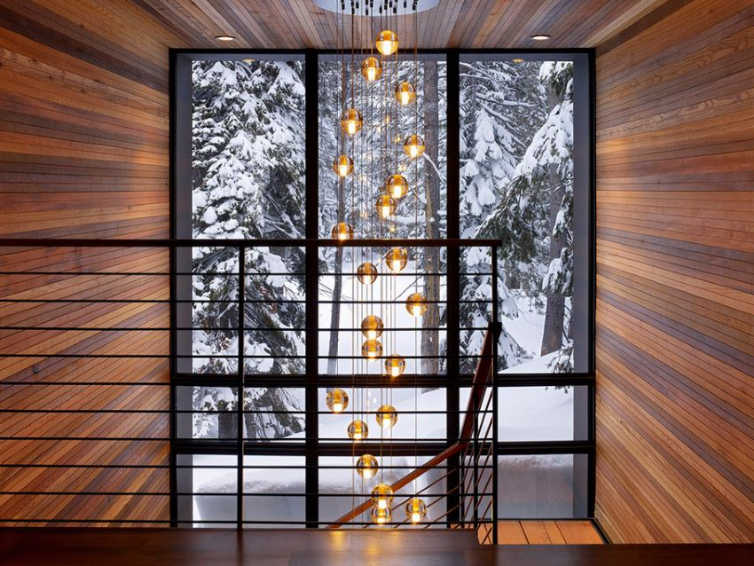Modern staircase with a snowy wooded view outside