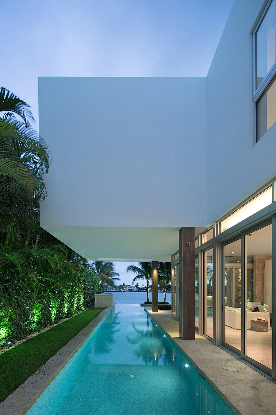 Natural greenery around the pool beautifully illuminated