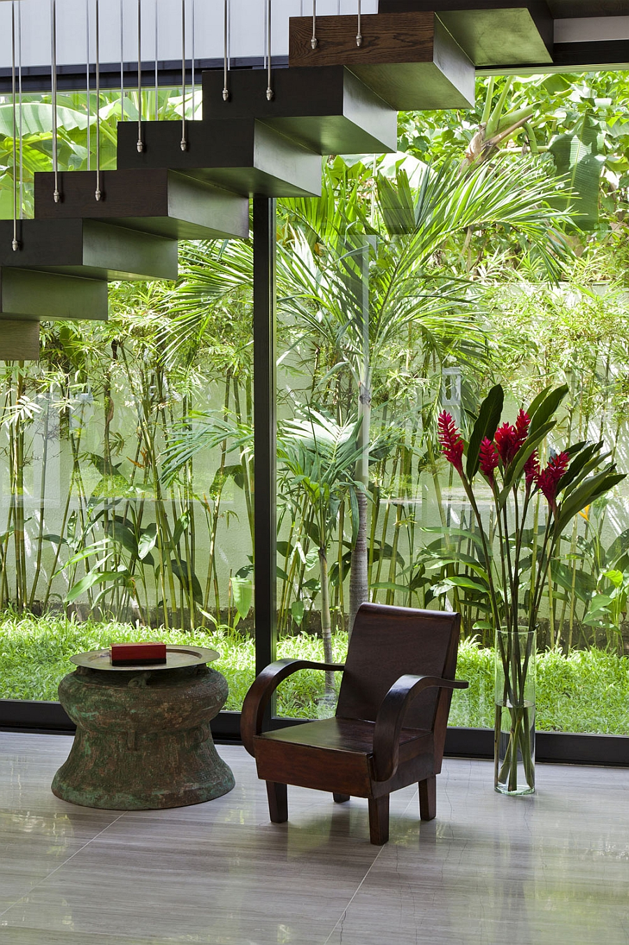 Natural greenery outside becomes a part of the indoors