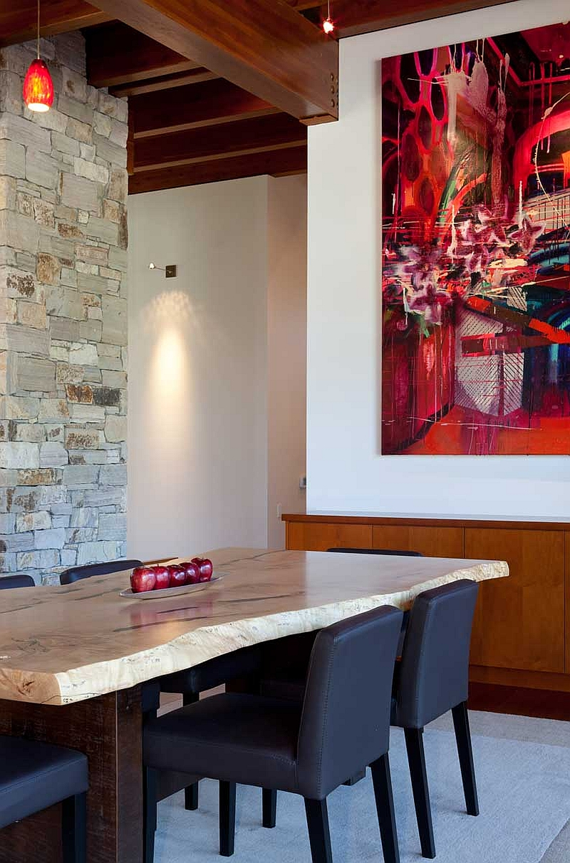 Natural stone dining table and fiery reds in the dining room