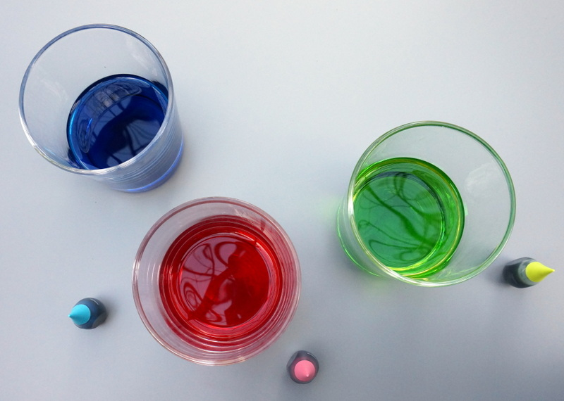 Neon food coloring in glasses