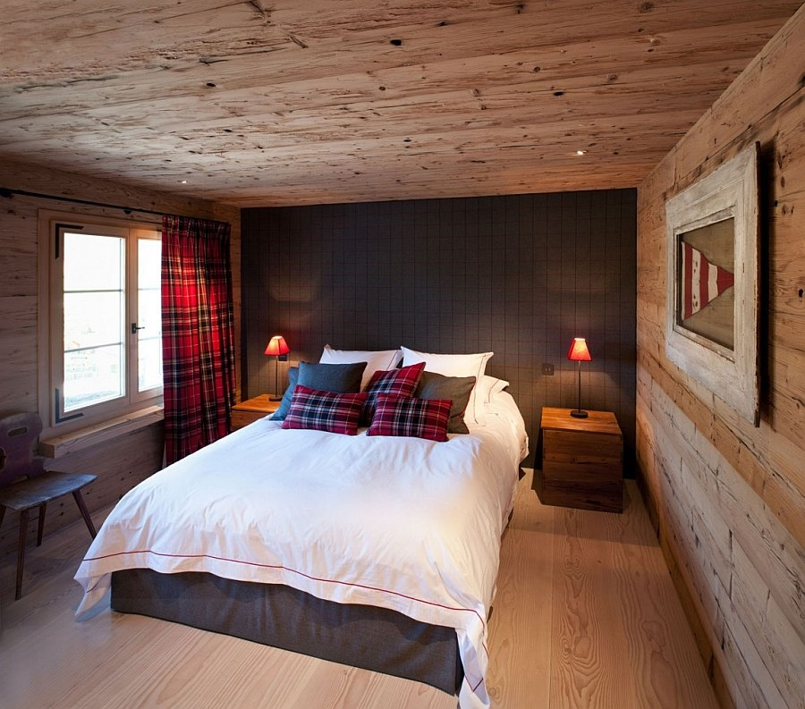 Neutral color palette in the chalet bedroom with pops of red