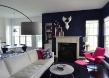 Old Navy from Benjamin Moore on the walls along with bright fuchsia decor