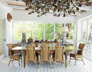 Organic textures and painted wood floor give the dining room a relaxed, holiday vibe
