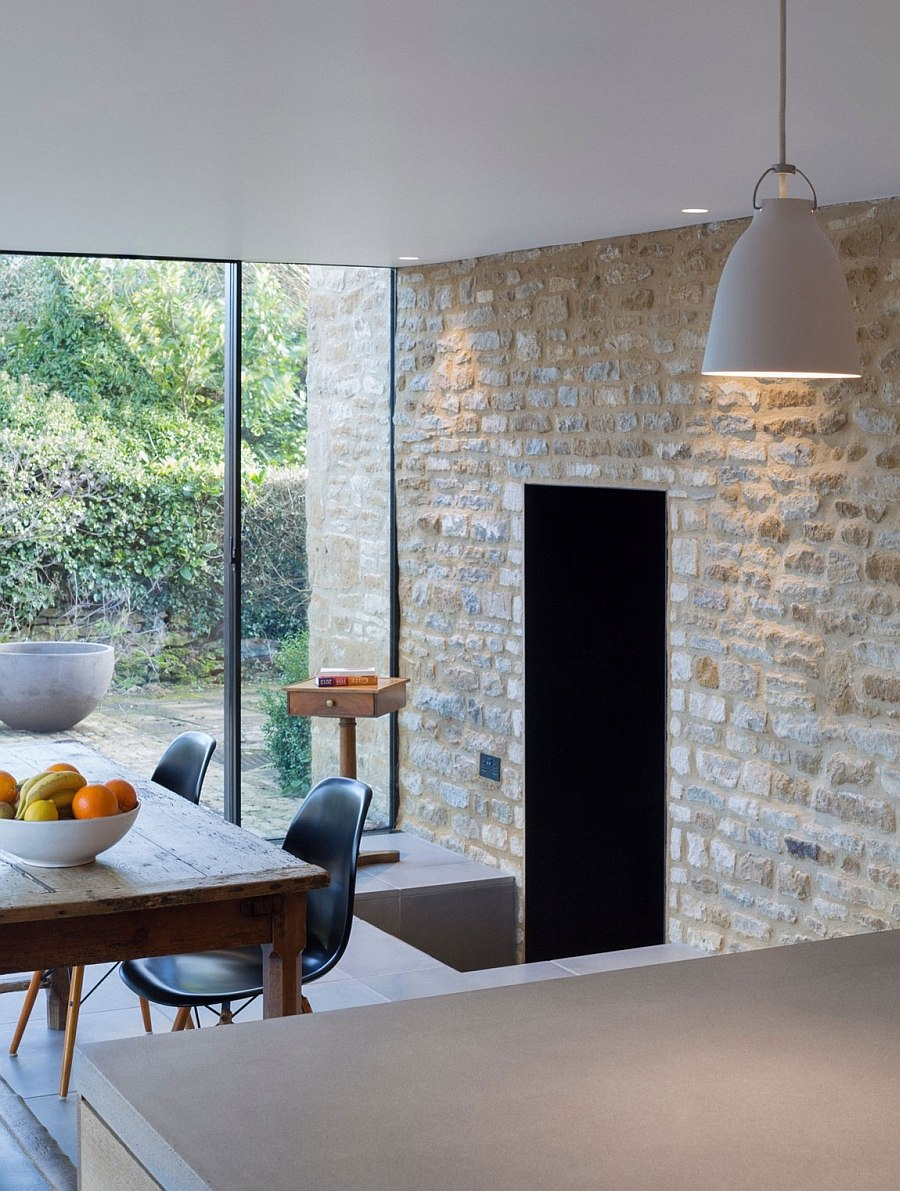 Original stone walls act as the backdrop for the new dining space and kitchen