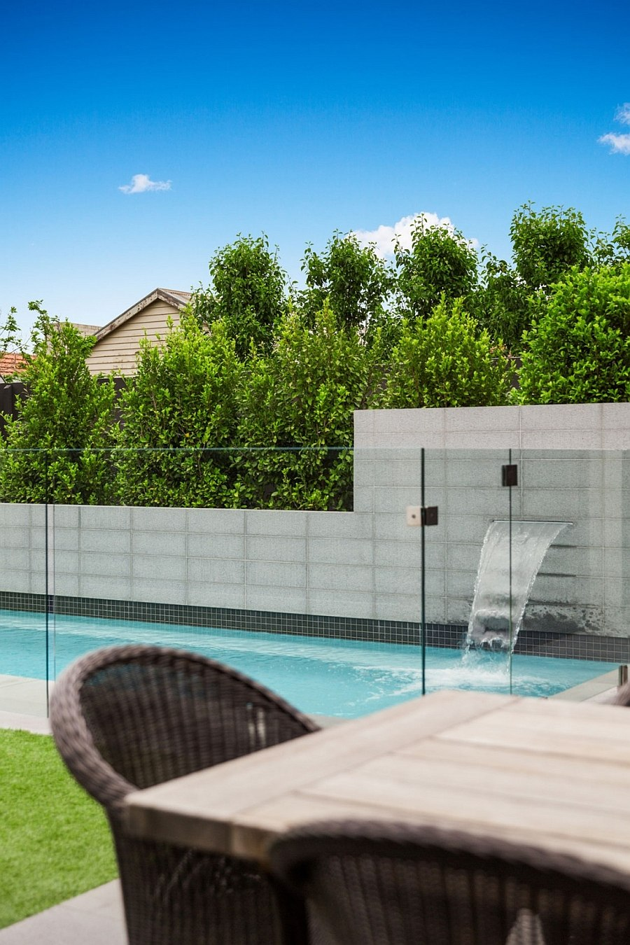 Outdoor pool and water feature for the modern home
