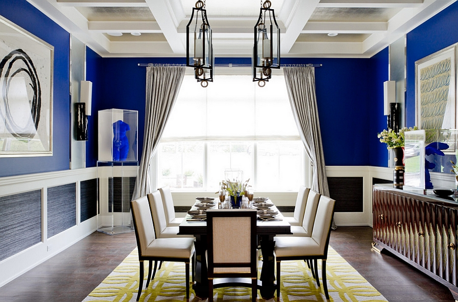 Patterned rug adds yellow to the dining room in blue [Photography: Rikki Snyder]
