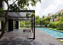 Pergola structure offers ample shade next to the pool area