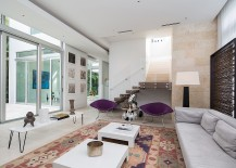 Plush purple chairs add color to the living room 217x155 Dramatic Miami Residence Offers Luxury Draped in Coastal Beauty