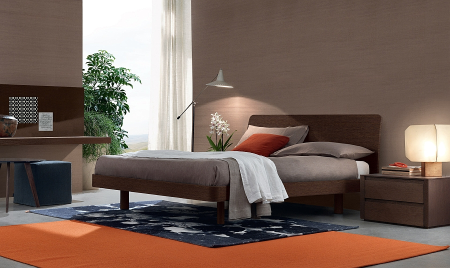 Pops of orange enliven the bedroom