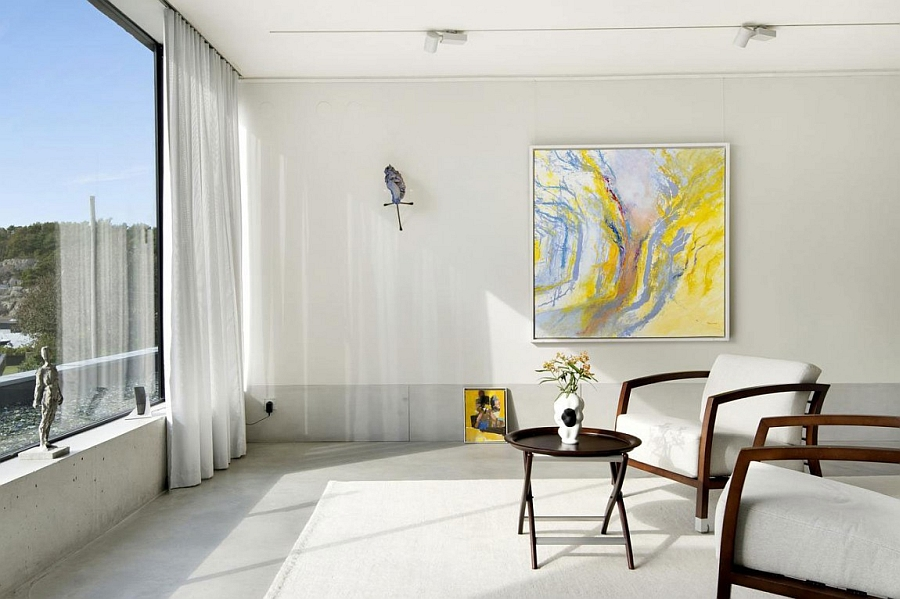 Pops of yellow brighten the sleek, minimalist beach villa in Sweden