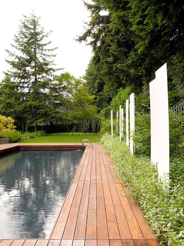Powder-coated white steel and back-lit translucent panels bring privacy to the backyard