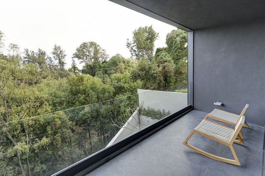 Recessed balcony of the house offers lovely view of the canopy outside