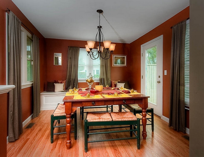 Red and green dining room has a casual, fun vibe [Design: Mitchell Construction Group]