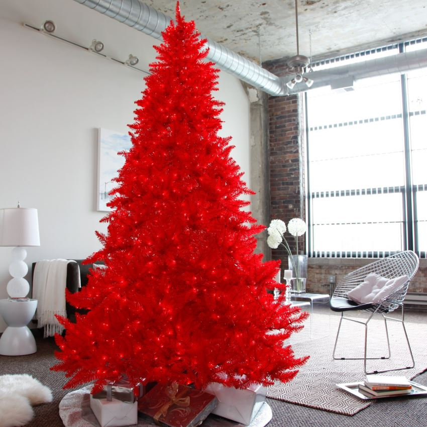 Red pre-lit Christmas tree in a neutral modern space