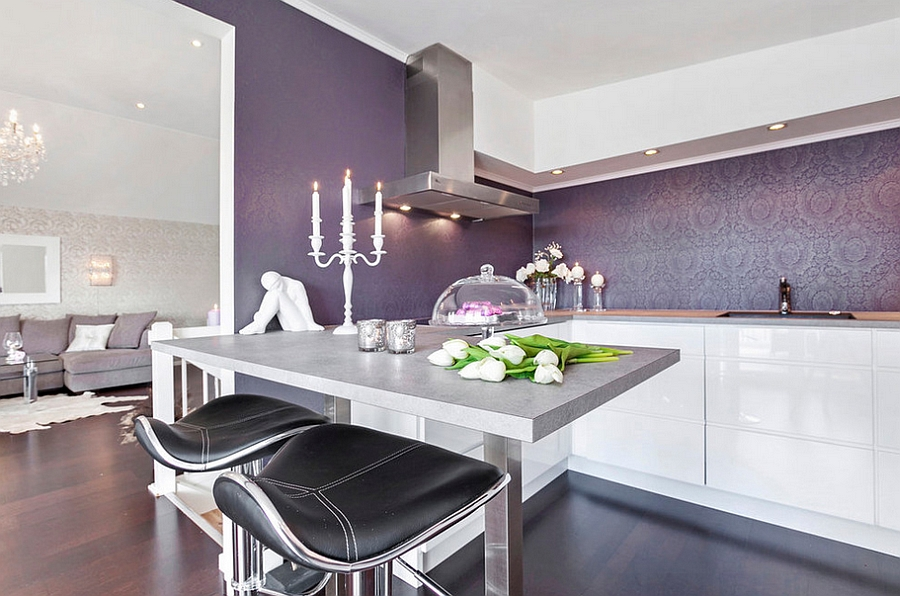 Regal purple wallpaper backsplash in the kitchen [Design: Sylvia Fridman]
