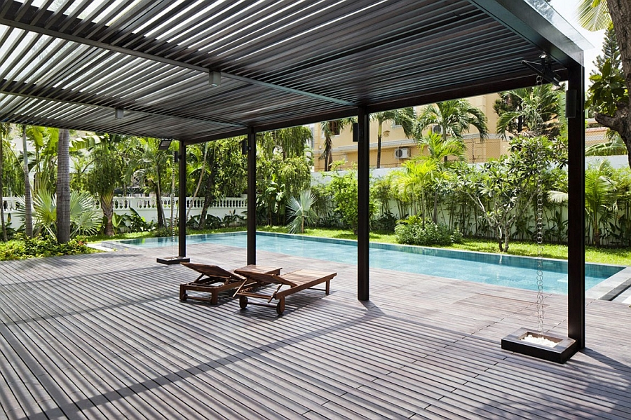 Relax under the shade on the expansive pool deck