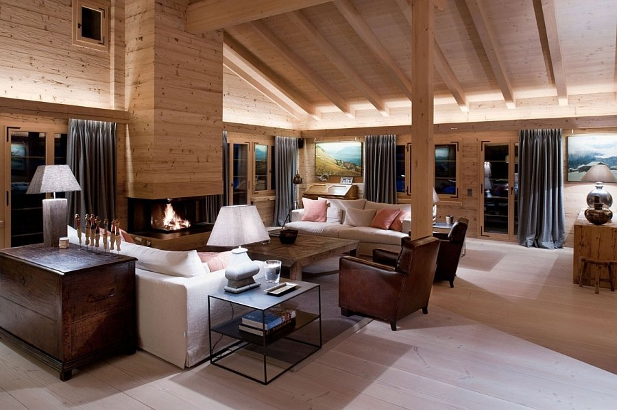 Rough sawn Austrian timber cover the living space walls Chalet Gstaad: Luxurious Holiday Retreat Nestled in the Heart of the Swiss Alps