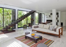 Sculprural staircase design elevates the appeal of the living room