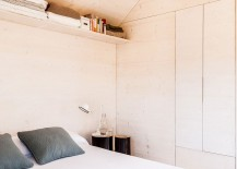 Simple storage and decor give the bedroom a spacious vibe