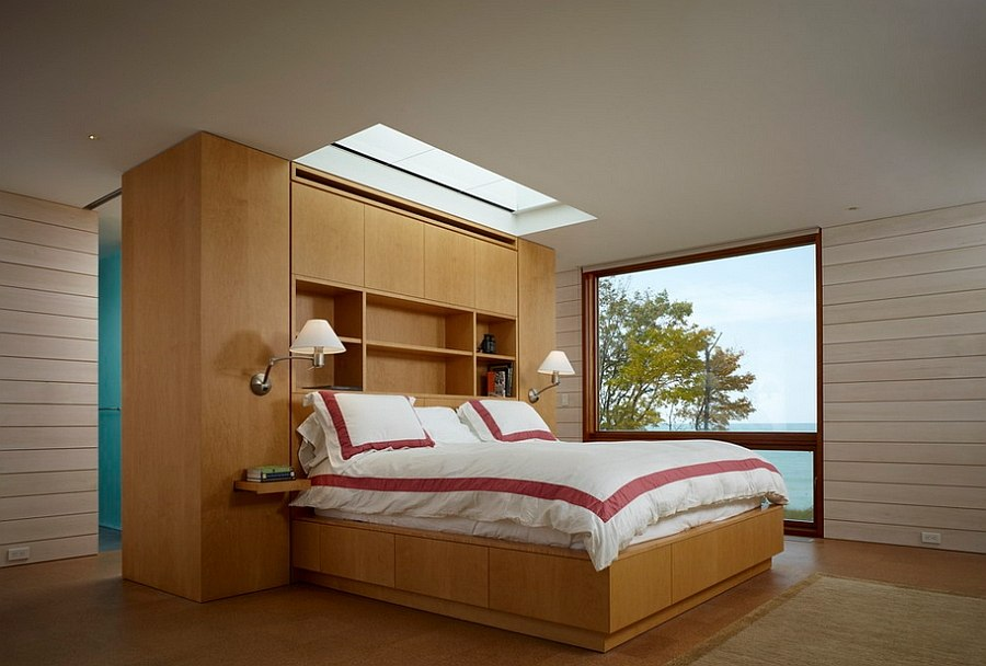 Skylight above the headboard gives the ceiling an exciting twist [Design: Wheeler Kearns Architects]