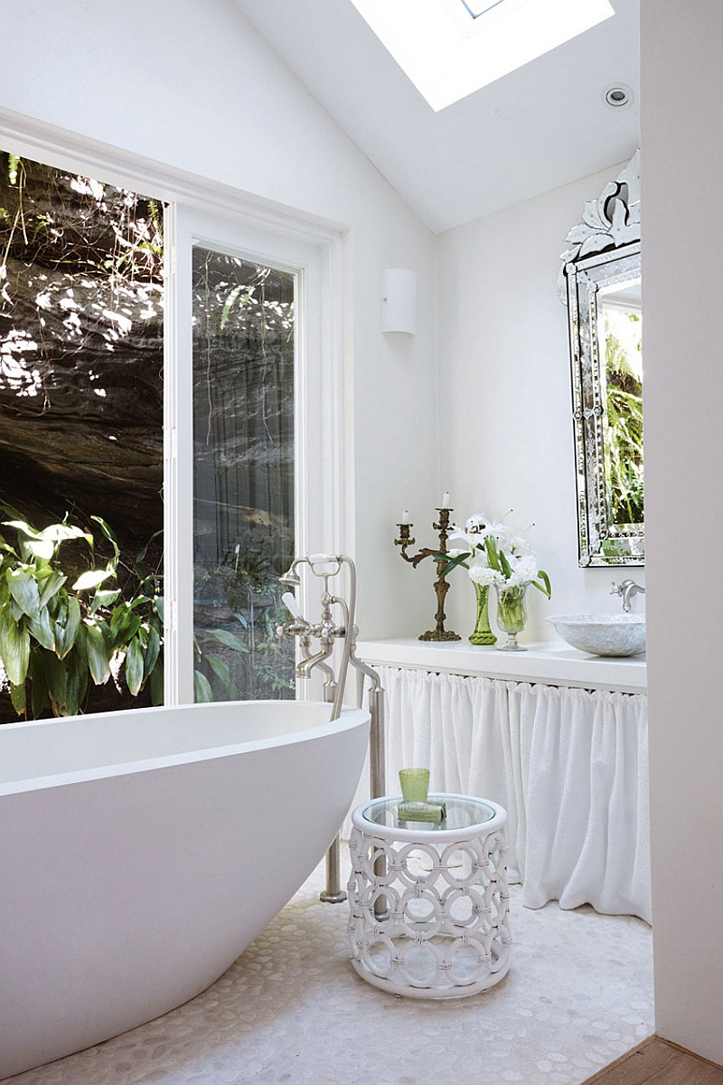 Skylight in the bathroom that is connected with the landscape outside