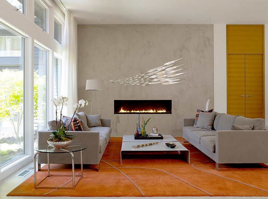 Sleek, contemporary fireplace and concerete wall become the focal point in the room