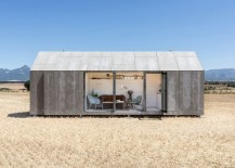 Sliding cement panels and glass doors connect the small portable house with outdoors 217x155 Chic Portable Micro Home Exudes Simplicity and Sustainability