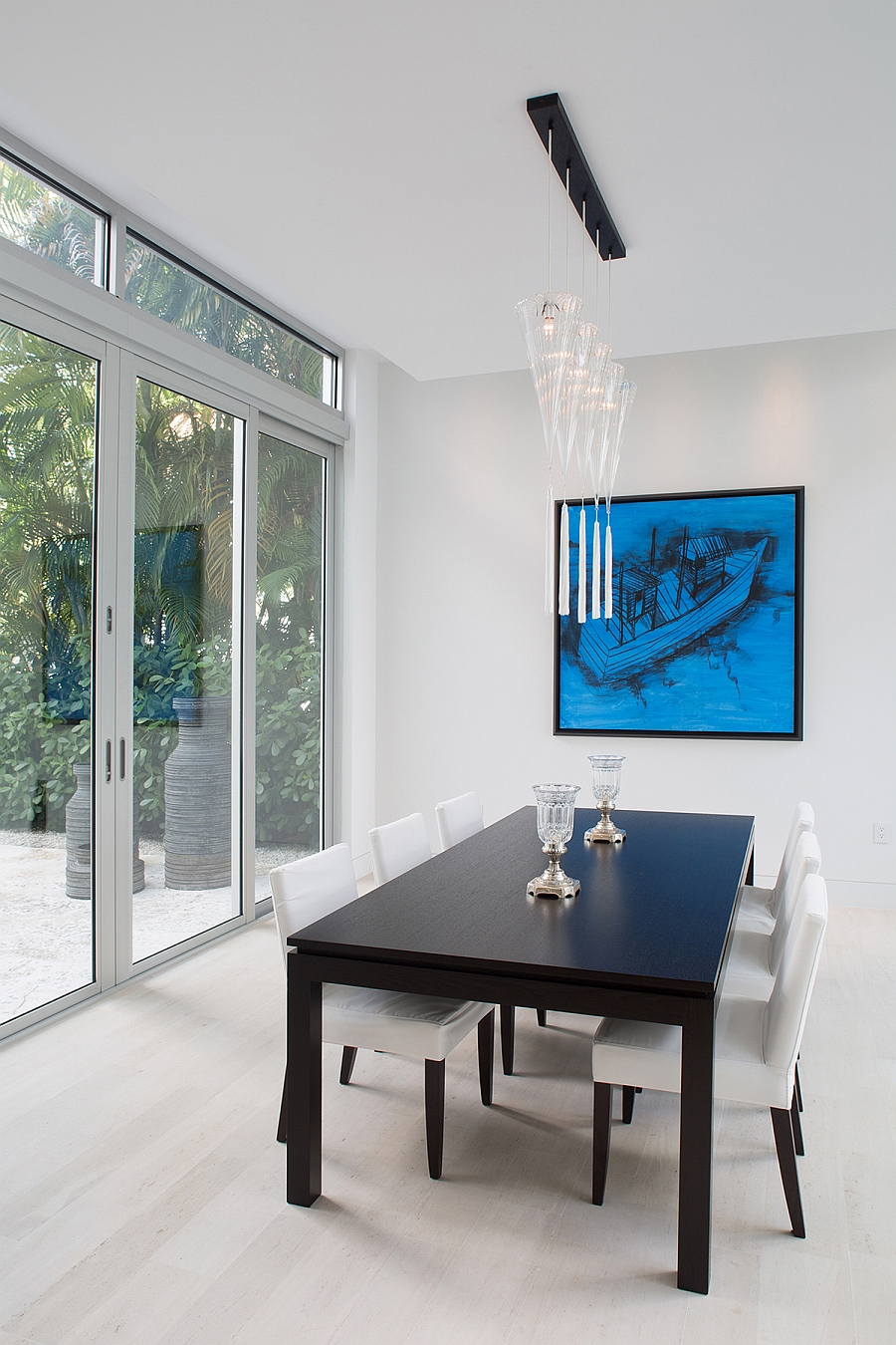Sliding glass doors and pops of blue for the dining room